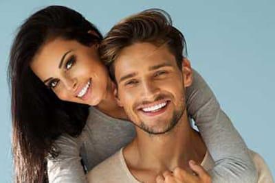 smiling couple at calgary dentist