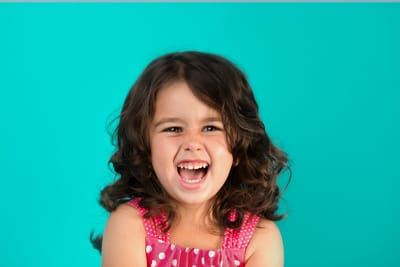 child smiling at calgary dentist