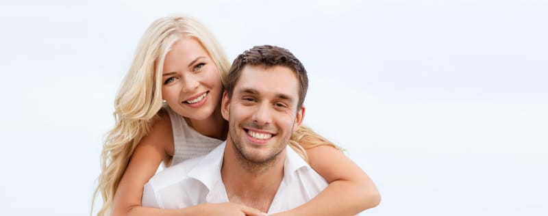 smiling couple with bright smiles after teeth whitening