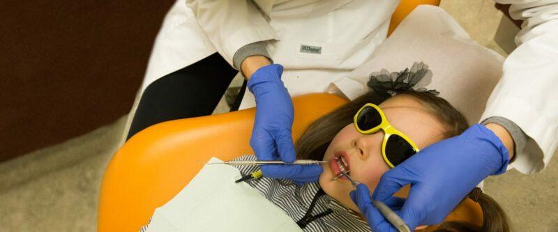 girl getting a dental exam