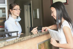woman at front desk of calgary dental office