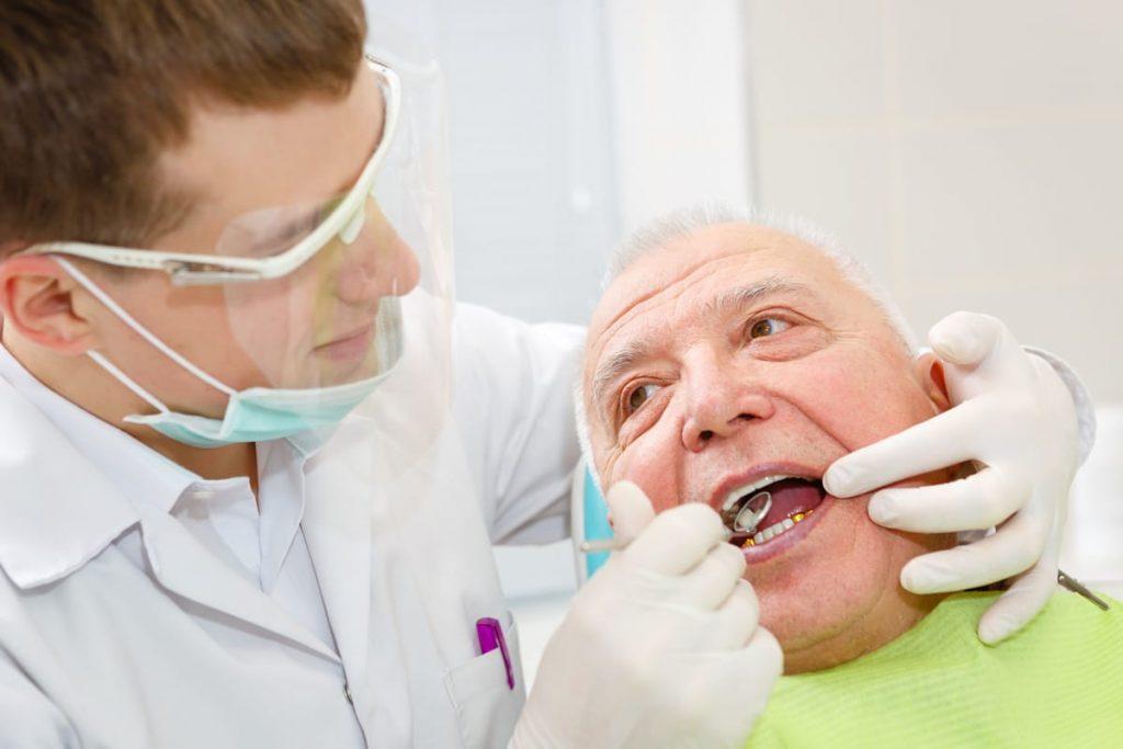 elderly man getting a dental filling